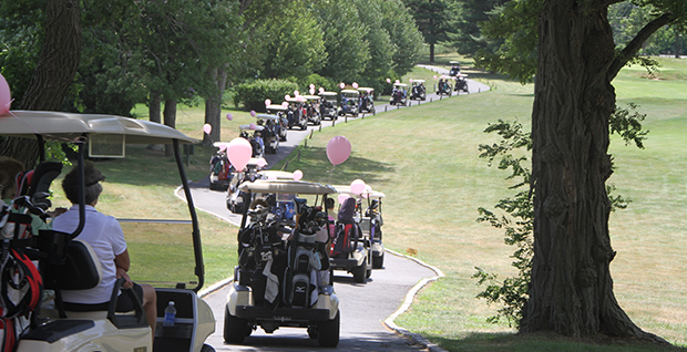 Golf Carts with Pink Balloons at the Annual Edge Golf Outing